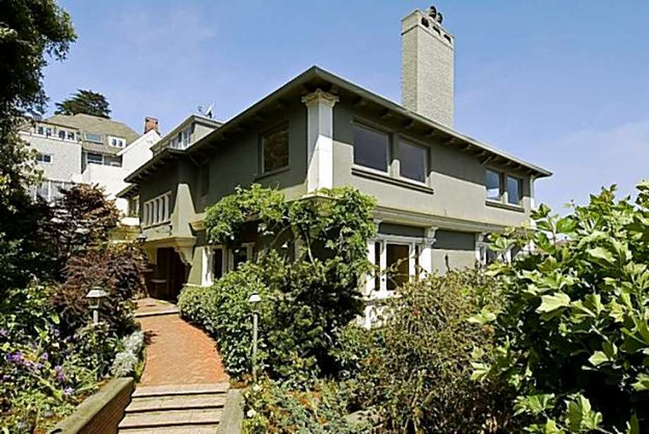 This grand turn-of-the-Century Pacific Heights home on a corner lot on Pierce Street was designed by renowned architect Edgar Mathews and is on the market for $4.95 million or about $1,410 per square foot Photo: OpenHomesPhotography.com