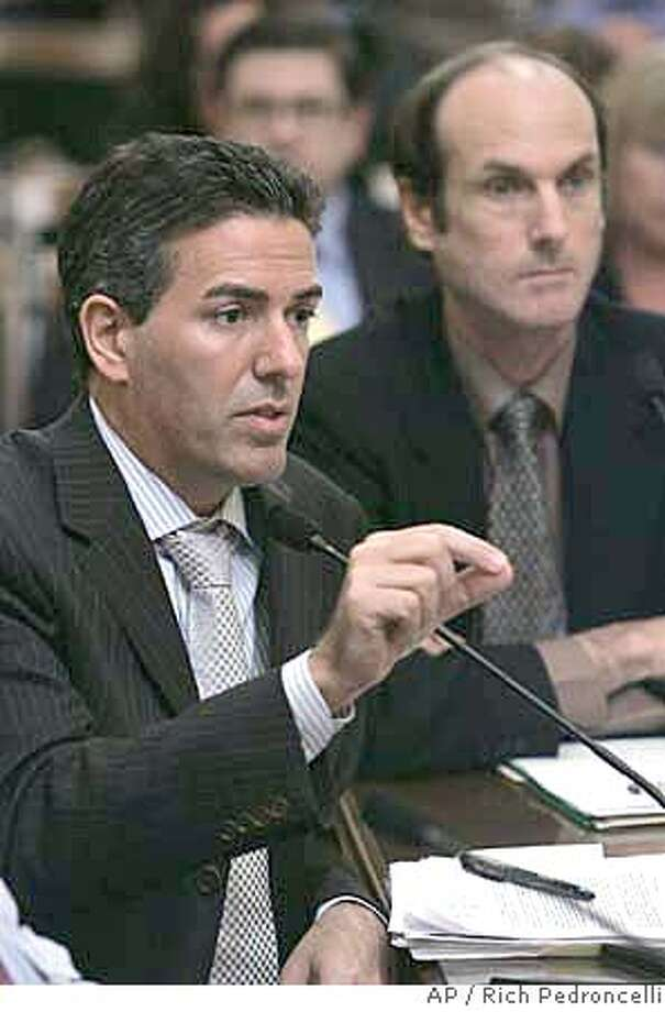 ###Live Caption:Wayne Parcelle, president and Chief Executive Officer of the Humane Society of the United States, urges members of the Assembly Public Safety Committee to approve his measure that would ban slaughterhouses from processing meat from sick cows during a hearing at the Capitol in Sacramento, Calif., Tuesday, April 1, 2008. The measure is in response to the scandal over a Southern California slaughterhouse that improperly allowed so-called downer cattle into the food supply, leading to the recall of 143 million pounds of beef. If approved by the Legislature and signed by the governor, the bill would set punishment at a fine for a first violation, one-year suspension for a second and permanent shutdown for a third. (AP Photo/Rich Pedroncelli)###Caption History:Wayne Parcelle, president and Chief Executive Officer of the Humane Society of the United States, urges members of the Assembly Public Safety Committee to approve his measure that would ban slaughterhouses from processing meat from sick cows during a hearing at the Capitol in Sacramento, Calif., Tuesday, April 1, 2008. The measure is in response to the scandal over a Southern California slaughterhouse that improperly allowed so-called downer cattle into the food supply, leading to the recall of 143 million pounds of beef. If approved by the Legislature and signed by the governor, the bill would set punishment at a fine for a first violation, one-year suspension for a second and permanent shutdown for a third. (AP Photo/Rich Pedroncelli)###Notes:Wayne Parcelle###Special Instructions: Photo: Rich Pedroncelli