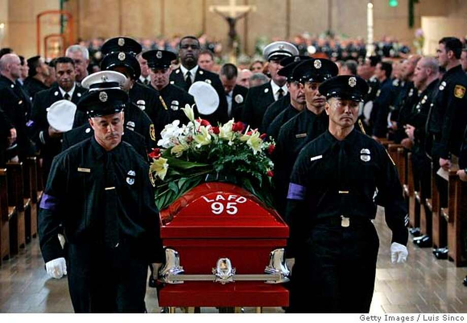 ###Live Caption:LOS ANGELES - APRIL 4: Pallbearers carry the casket of L.A. city firefighter Brent Lovrien out of the Lady of Our Angels Cathedral church following a memorial service on April 4, 2008 in Los Angeles, California. Lovrien was killed last week from injuries sustained in an explosion at a fire in Westchester, CA. (Photo by Luis Sinco-Pool/Getty Images)###Caption History:LOS ANGELES - APRIL 4: Pallbearers carry the casket of L.A. city firefighter Brent Lovrien out of the Lady of Our Angels Cathedral church following a memorial service on April 4, 2008 in Los Angeles, California. Lovrien was killed last week from injuries sustained in an explosion at a fire in Westchester, CA. (Photo by Luis Sinco-Pool/Getty Images)###Notes:City Mourns Fallen Firefighter###Special Instructions: Photo: Pool