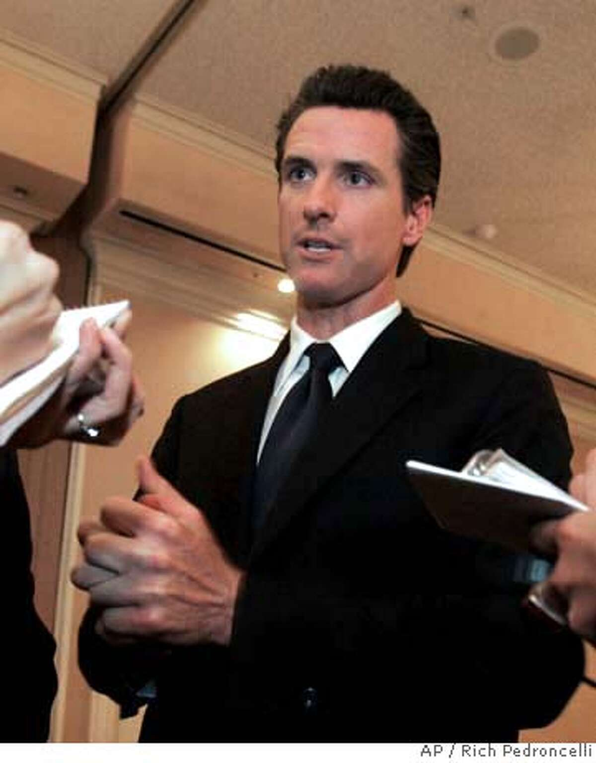 ###Live Caption:San Francisco Mayor Gavin Newsom talks to reporters after his appearance before the Sacramento Press Club in Sacramento, Calif., Tuesday, March 25, 2008. Newsom is criticizing deep cuts to California's Medi-Cal program and says he is considering a lawsuit to reinstate some of the funding. (AP Photo/Rich Pedroncelli)###Caption History:San Francisco Mayor Gavin Newsom talks to reporters after his appearance before the Sacramento Press Club in Sacramento, Calif., Tuesday, March 25, 2008. Newsom is criticizing deep cuts to California's Medi-Cal program and says he is considering a lawsuit to reinstate some of the funding. (AP Photo/Rich Pedroncelli) Ran on: 03-26-2008 San Francisco Mayor Gavin Newsom says the 10 percent reduction in Medi-Cal payments would impose an unfair burden on the citys taxpayers. Ran on: 03-26-2008 San Francisco Mayor Gavin Newsom says the 10 percent reduction in Medi-Cal payments would impose an unfair burden on the citys taxpayers.###Notes:Gavin Newsom###Special Instructions: