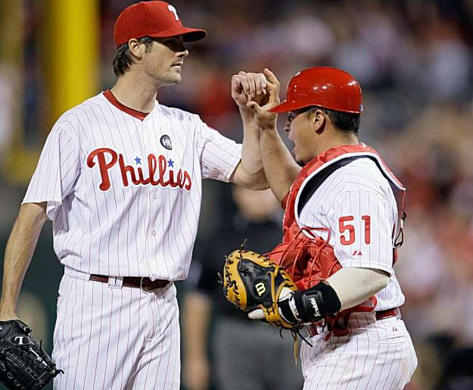 Philadelphia Phillies pitcher Cole Hamels, left, and catcher Carlos Ruiz celebrate after a baseball game against the San Francisco Giants, Tuesday, Sept. 1, 2009, in Philadelphia. The Phillies won 1-0. (AP Photo/Matt Slocum) Photo: Matt Slocum, AP