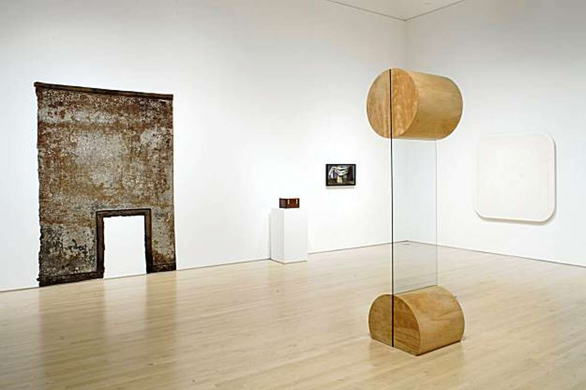 """Installation view of """"Not New Work: Vincent Fecteau Selects from the Collection"""" (2009) at SFMOMA with Christopher Wilmarth's glass and wood sculpture """"New"""" (1968). Works by Robert Overby, Ralph Humphrey, Charles Howard and H. C. Westermann on walls"""