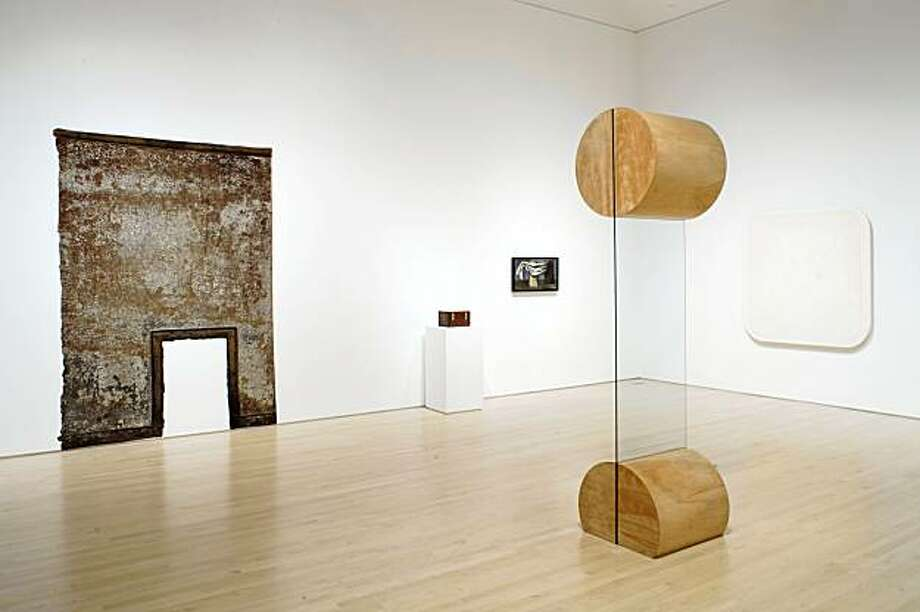 """Installation view of """"Not New Work: Vincent Fecteau Selects from the Collection"""" (2009) at SFMOMA with Christopher Wilmarth's glass and wood sculpture """"New"""" (1968). Works by Robert Overby, Ralph Humphrey, Charles Howard and H. C. Westermann on walls Photo: Ian Reeves, SFMOMA"""