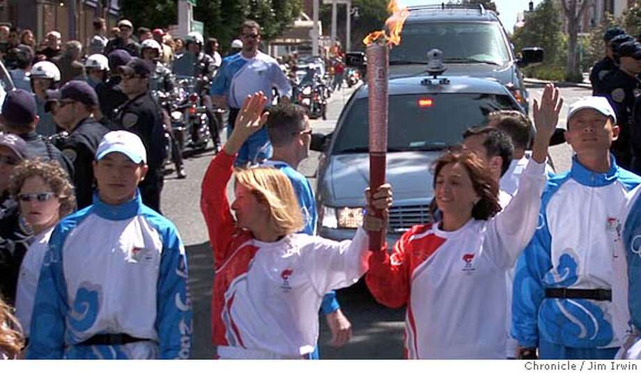 This is a frame grab from video showing Chinese security personnel surrounded the torchbearers on Van Ness Ave. on Wednesday, April 9, 2008 during the Olympic Torch Relay in San Francisco, Calif. Photo by Jim Irwin / San Francisco Chronicle  Ran on: 04-13-2008  Chinese security personnel accompany the runners. Photo: Jim Irwin