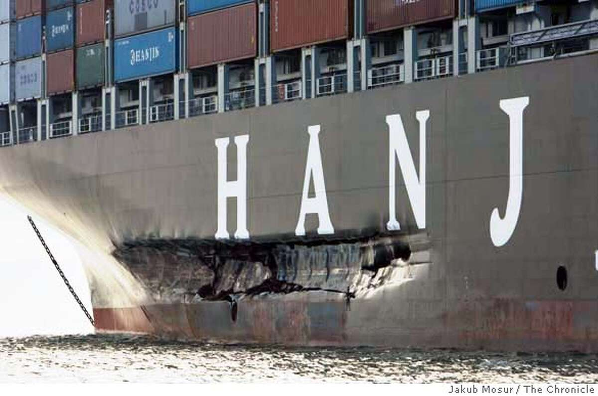 ###Live Caption:Cosco Busan sits south of the Bay Bridge two days after it had struck a Bay Bridge tower near Yerba Buena Island on Wednsday November 7, 2007 spilling 58,000 gallons of fuel into San Francisco Bay. Event on 11/9/07 in San Francisco. Jakub Mosur / The Chronicle###Caption History:CoscoBusan10_07_JMM.JPG Cosco Busan sits south of the Bay Bridge two days after it had struck a Bay Bridge tower near Yerba Buena Island on Wednsday November 7, 2007 spilling 58,000 gallons of fuel into San Francisco Bay. Event on 11/9/07 in San Francisco. Jakub Mosur / The Chronicle###Notes:###Special Instructions:MANDATORY CREDIT FOR PHOTOG AND SF CHRONICLE/NO SALES-MAGS OUT