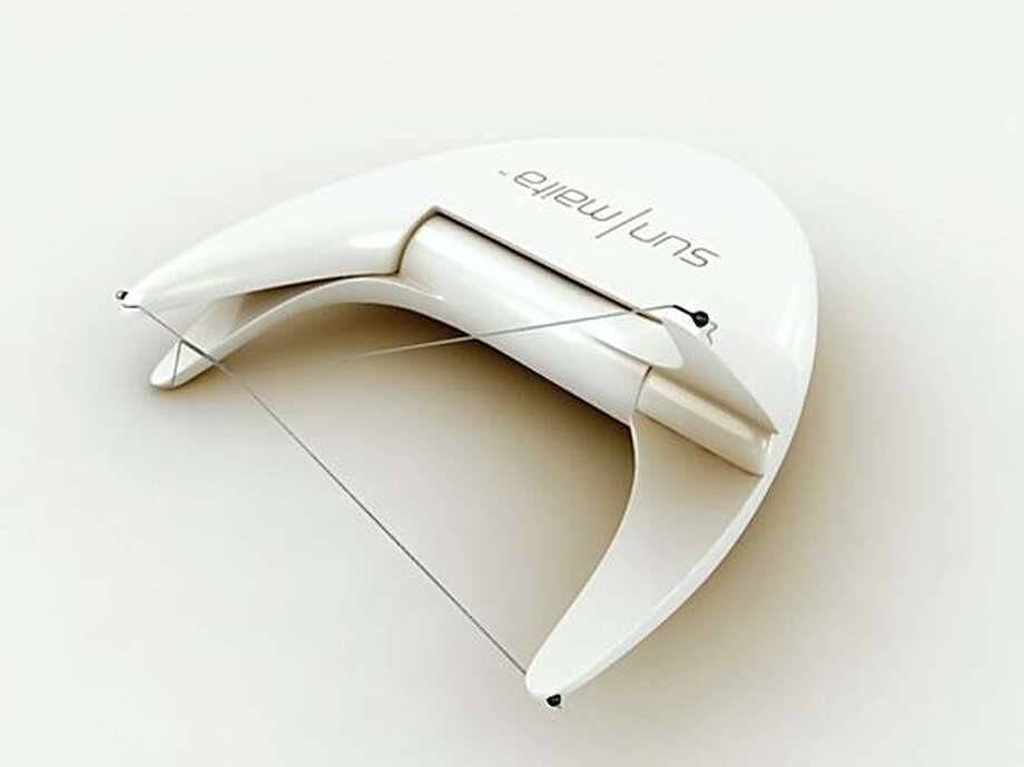 The Threader hand-held device allows users to remove hair by the threading technique - twisted threads glide and grip the hair, allowing you to roll it up and out of the follicle -- by yourself, instead of having to go to a salon to do it. It was created by two San Francsico aestheticians. The company is SunMaita Inc. Photo: Courtesy SunMaita Inc.
