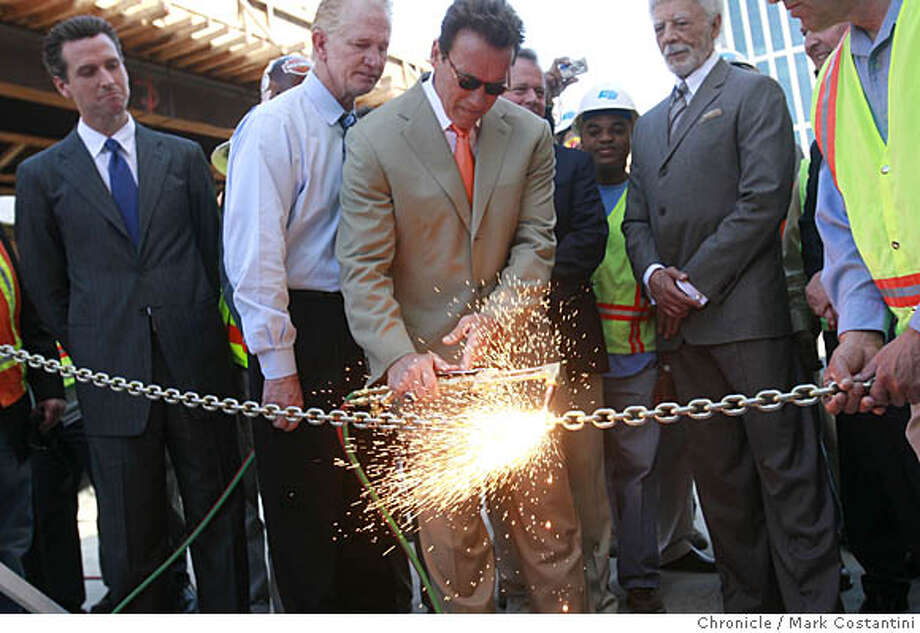 California Governor Arnold Schwarzenegger takes a blowtorch to a chain to celebrate then new eastbound lanes on the San Francisco approach to the Bay on Friday, April 11, 2008 in San Francisco, Calif. A blowtorch chain cutting was how the opening ceremony of the Bay was celebrated when it first opened. Far left is San Francisco Maor Gavin Newsom and on far right is Oakland Mayor Ron Dellums.  Photo by Mark Costantini / San Francisco Chronicle. Photo: Mark Costantini