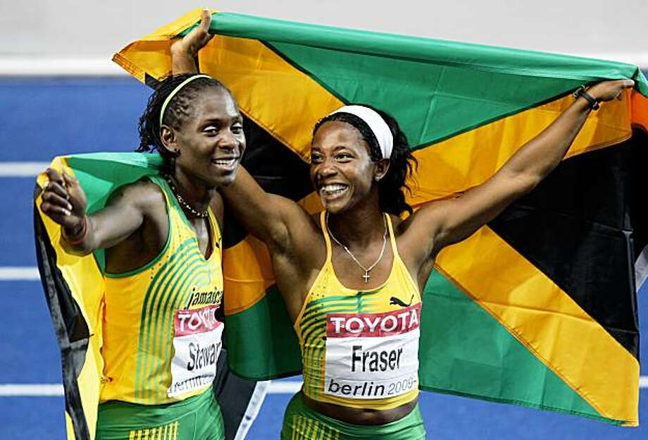 BERLIN - AUGUST 17:  (L-R) Kerron Stewart of Jamaica and Shelly-Ann Fraser of Jamaica celebrate silver and gold respectively after the women's 100 Metres Final during day three of the 12th IAAF World Athletics Championships at the Olympic Stadium on August 17, 2009 in Berlin, Germany.  (Photo by Mark Dadswell/Getty Images) Photo: Mark Dadswell, Getty Images