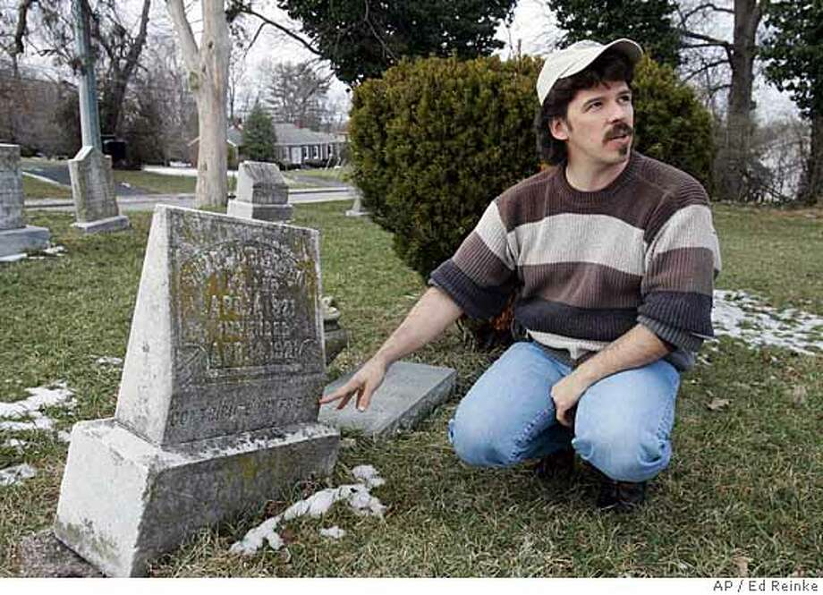 "**ADVANCE FOR SUNDAY, MARCH 30** Todd Matthews at the grave marker of ""Some Mother's Boy"" is shown in the Georgetown Cemetery in Georgetown, Ky., Friday, Feb. 15, 2008. (AP Photo/Ed Reinke) Photo: Ed Reinke"