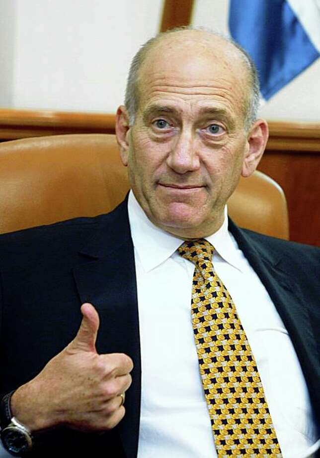 JERUSALEM, ISRAEL - JULY 8:  Israeli Prime Minister Ehud Olmert gestures during a meeting with U.S. astronaut Leland D. Melvin July 8, 2008 in in Jerusalem, Israel. According to reports, Olmert will be questioned for a third by police about an alleged bribe he received from a American businessman.  (Photo by Gali Tibbon-Pool/Getty Images) Photo: Pool, Getty Images