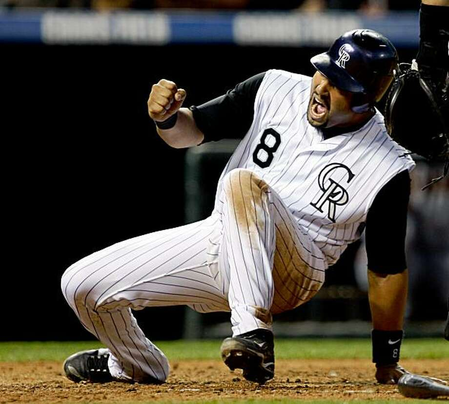 Colorado Rockies' Yorvit Torrealba reacts after scoring on a triple by pinch-hitter Seth Smith against the San Francisco Giants in the sixth inning of a baseball game  in Denver on Saturday, Aug. 22, 2009.(AP Photo/David Zalubowski) Photo: David Zalubowski, AP