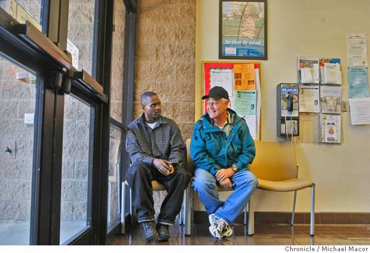 Ron Saunders, left, with his client Henry Garcia, on Mar. 14, 2008, Saunders has directing to him to medical, dental and social services every since he was parolled from prison in June of 2007. Saunders is part of the staff at the Southeast Health Clinic, Transition department in San Francisco, Calif. which provides health care for parolees that are unable to pay for it. At the clinic, Saunders' works with every patient as a social worker in his always-busy schedule. Photo by Michael Macor/ San Francisco Chronicle Ran on: 03-30-2008 Community health worker Ron Sanders.