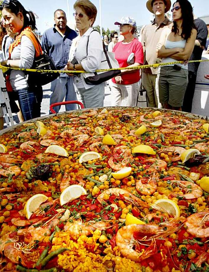 A long line stretched around Gerards Paella stand and their huge vats of paella. The restaurant is from Occidental and the favorite was seafood paella with chicken (shown). The first annual Eat Real festival finished up Sunday at Oakland's Jack London Square. About 30,000 a day showed up from Friday to Sunday to sample locally produced foods from the Bay Area. Photo: Brant Ward, The Chronicle