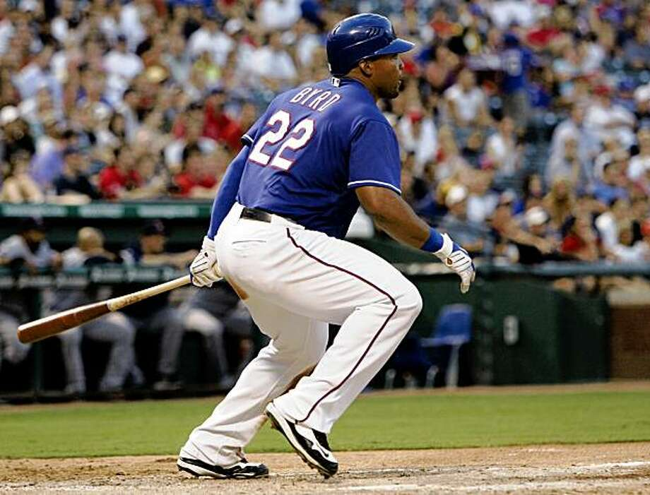 Texas Rangers' Marlon Byrd follows through on a single to right center off Minnesota Twins' Francisco Liriano that scored Ian Kinsler and Michael Young in the second inning of a baseball game, Monday, Aug. 17, 2009, in Arlington, Texas. The Rangers won 8-5.  (AP Photo/Tony Gutierrez) Photo: Tony Gutierrez, AP
