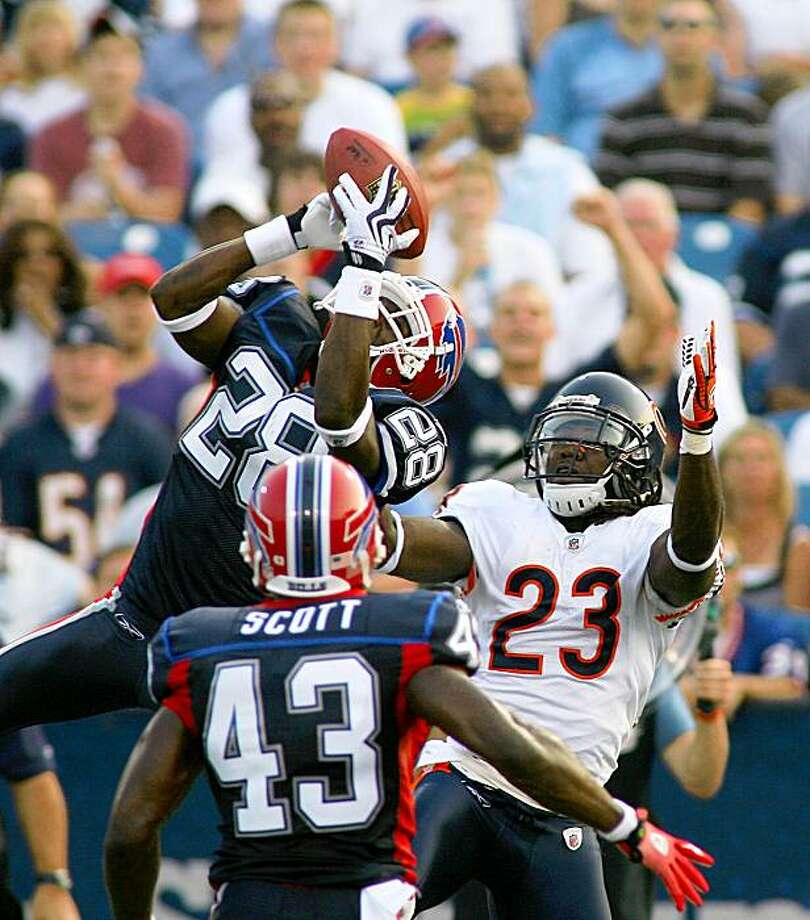 ORCHARD PARK, NY - AUGUST 15: Leodis McKelvin #28 of the Buffalo Bills intercepts a pass from Jay Cutler (not shown) intended for Devin Hester # 23 of the Chicago Bears on August 15, 2009 at Ralph Wilson Stadium in Orchard Park, New York. Bryan Scott #43 of the Bills looks on.  (Photo by Rick Stewart/Getty Images) Photo: Rick Stewart, Getty Images