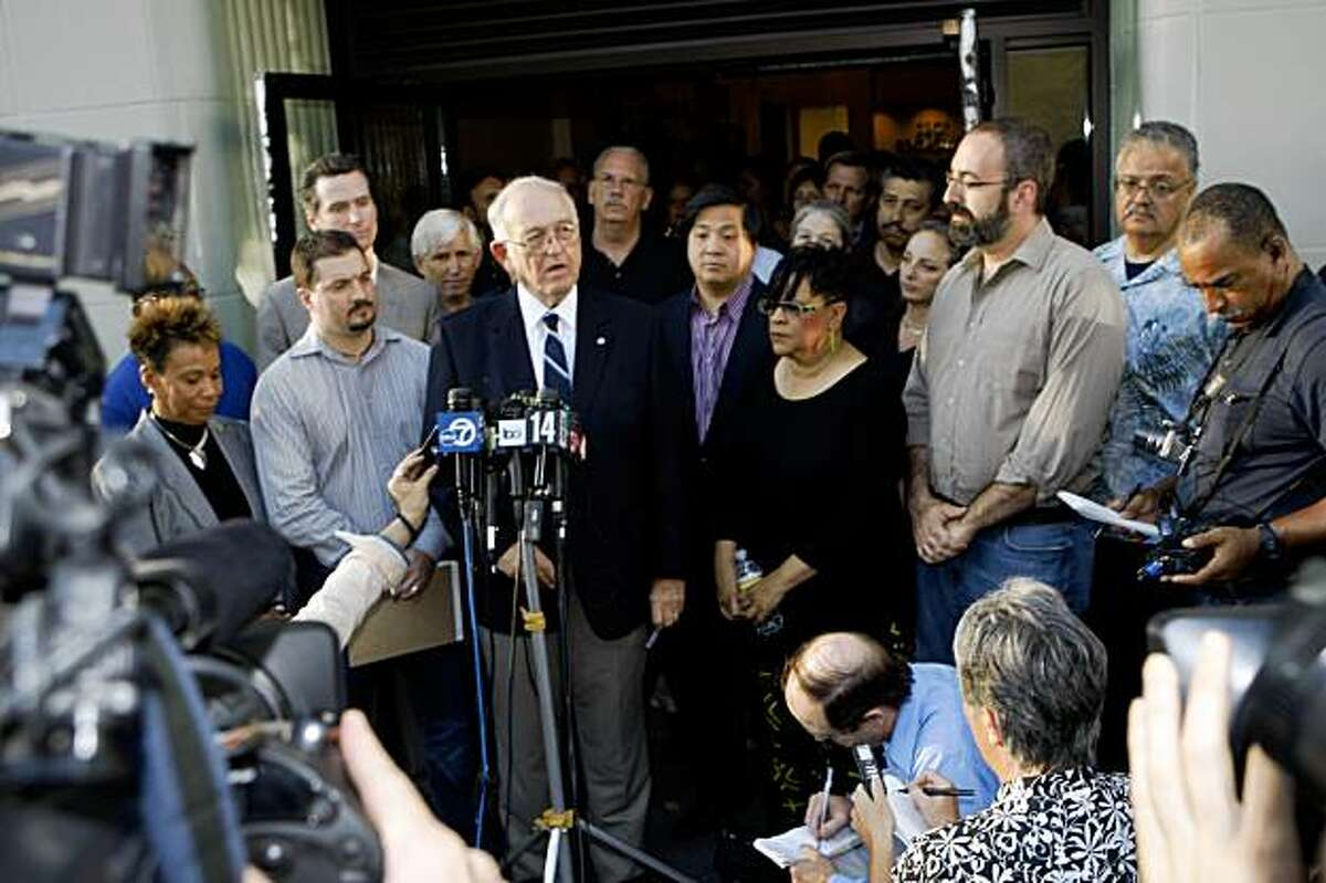 Thomas Blalock (third from left in front row), President of the BART board, addresses the media at a press conference announcing a tentative agreement in front 2201 22nd Street in Oakland, Calif. on Sunday, August 16, 2009.