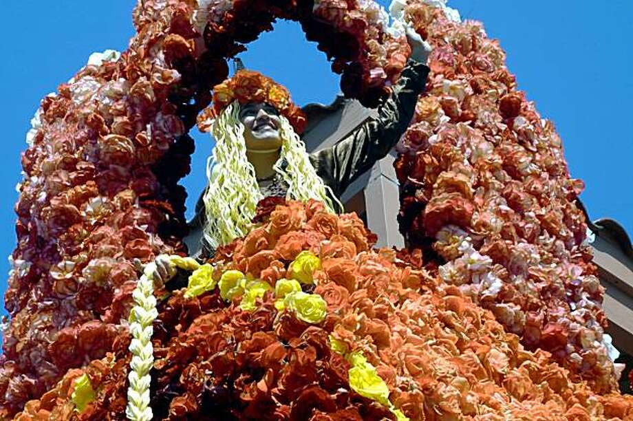 "A ""Rapaunzel"" rides a float in the Capitola Begonia Festival over Labor Day Weekend Photo: Santa Cruz County CVC"