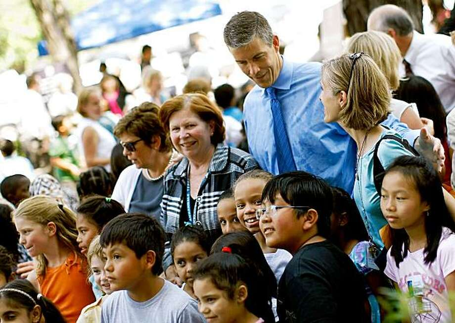 """WASHINGTON - AUGUST 18:  Education Secretary Arne Duncan greets guests after taking part in an event reading to school children at the Education Department August 18, 2009 in Washington, DC. Duncan read to school children as part of the """"Read To The Top"""" program.  (Photo by Win McNamee/Getty Images) Photo: Win McNamee, Getty Images"""