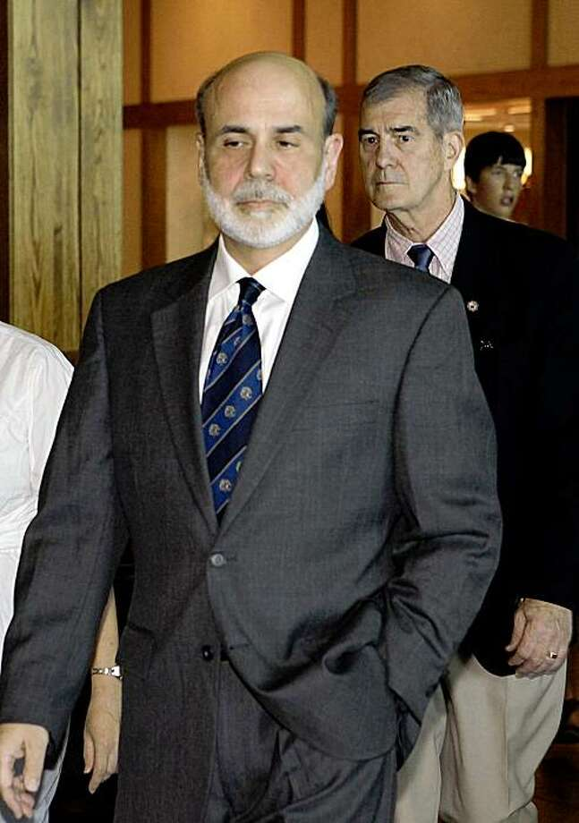 Federal Reserve Bank Chairman Ben Bernanke arrives at a dinner preceding the annual conference of the Federal Reserve in Jackson, Wyo., Thursday, Aug. 20, 2009.  (AP Photo/Reed Saxon) Photo: Reed Saxon, AP