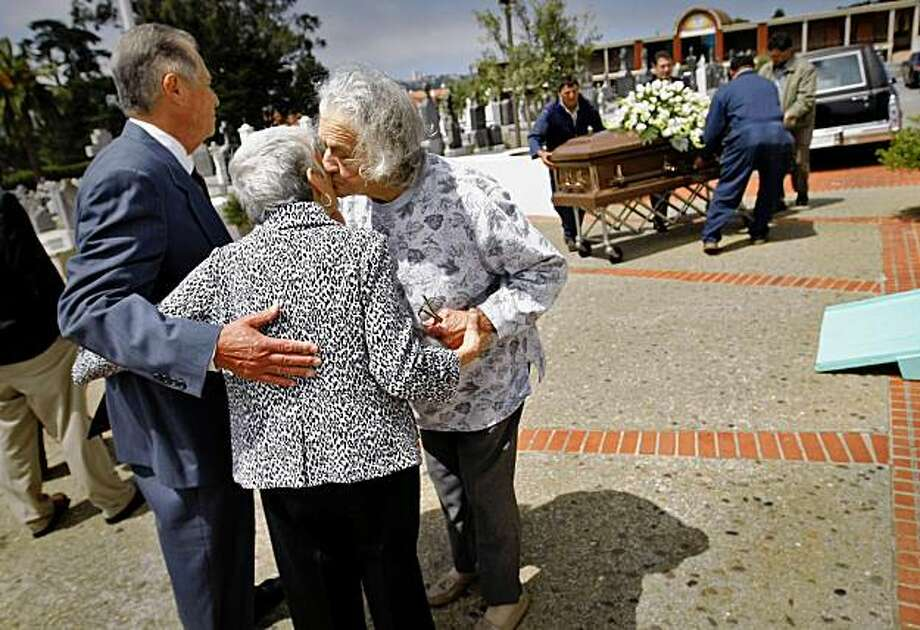 Violet Chelone (right) greets Lettie Volkoff  with and son manny Funes at the funeral of Letties' husband Gleb, Friday August 14, 2009, at the  Serbian Cemetery in San Francisco, Calif. Photo: Lacy Atkins, The Chronicle