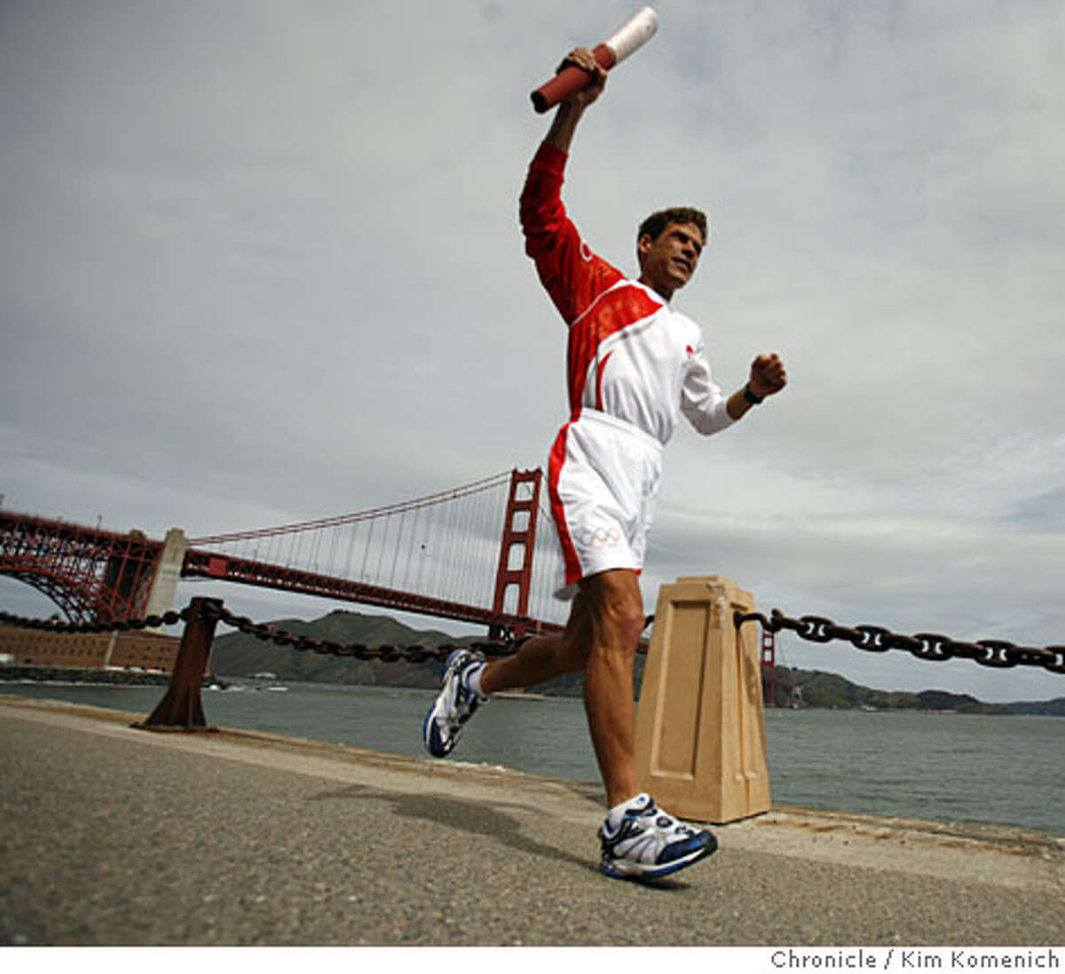 Olympic torchbearer Dean Karnazes, 44, of San Francisco participates in a photo-op for the San Francisco leg of the Olypic torch run near Fort Point in San Francisco, Calif., on April 8, 2008 Photo by Kim Komenich / San Francisco Chronicle