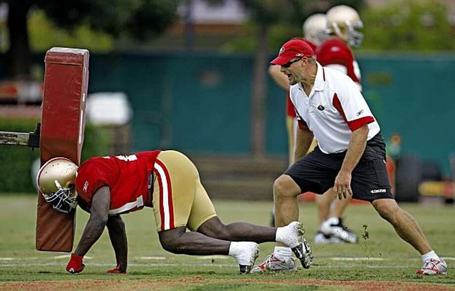 49er running back coach Tom Rathman works on blocking drills during the San Francisco 49ers during summer camp held at the 49ers headquarters in Santa Clara, Calif., on August 6,  2009. Photo: Frederic Larson, The Chronicle