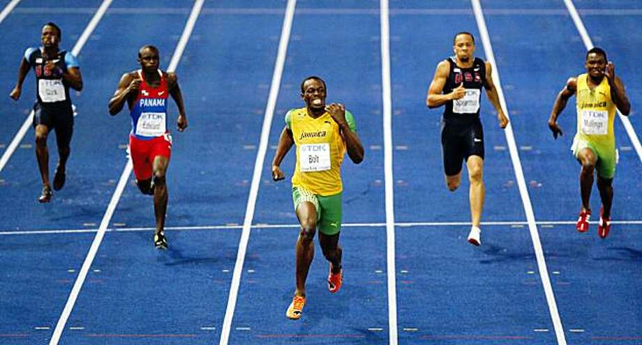Jamaica's Usain Bolt, center, runs to  setting a new World Record as he wins the Men's 200m final  during the World Athletics Championships in Berlin on Thursday, Aug. 20, 2009. (AP Photo/Michael Sohn) Photo: Michael Sohn, AP