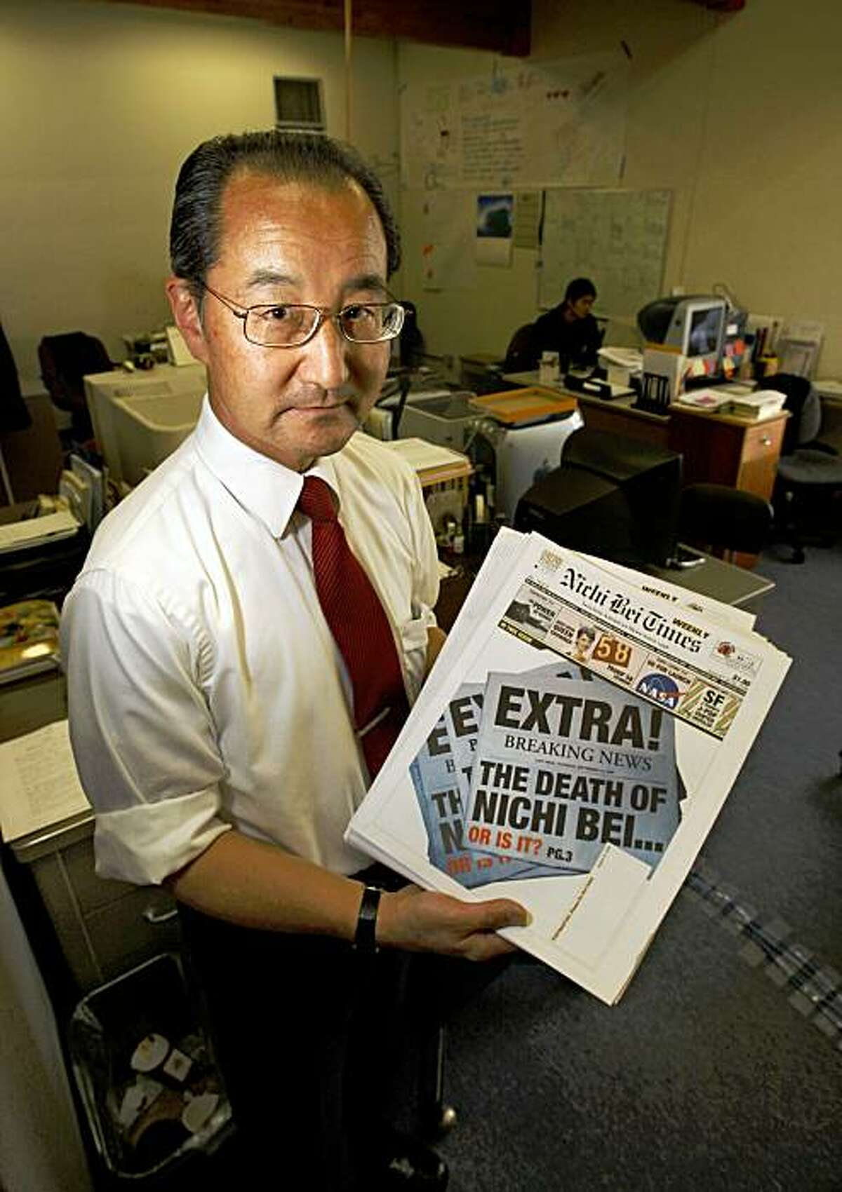 Mikio Okada the president of Nichi Bei Times holds up a extra of his newspaper which is the Northern California?•s oldest Japanese American newspaper (based in SF) who announced today that it would close after 63 years in business in San Francisco, Calif., on August 20, 2009.