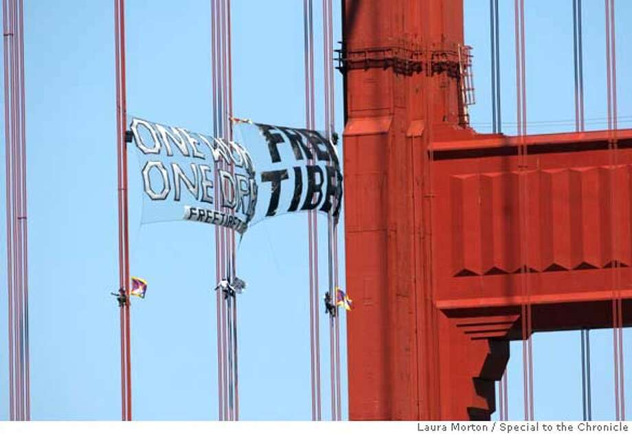 ###Live Caption:Three demonstrators scale the Golden Gate Bridge on Monday, April 7, 2008 in a protest intended to draw attention to Chinese human rights violations in Tibet. Photo by Laura Morton / Special to The Chronicle###Caption History:Three demonstrators scale the Golden Gate Bridge on Monday, April 7, 2008 in a protest intended to draw attention to Chinese human rights violations in Tibet. Photo by Laura Morton / Special to The Chronicle###Notes:###Special Instructions: Photo: Laura Morton