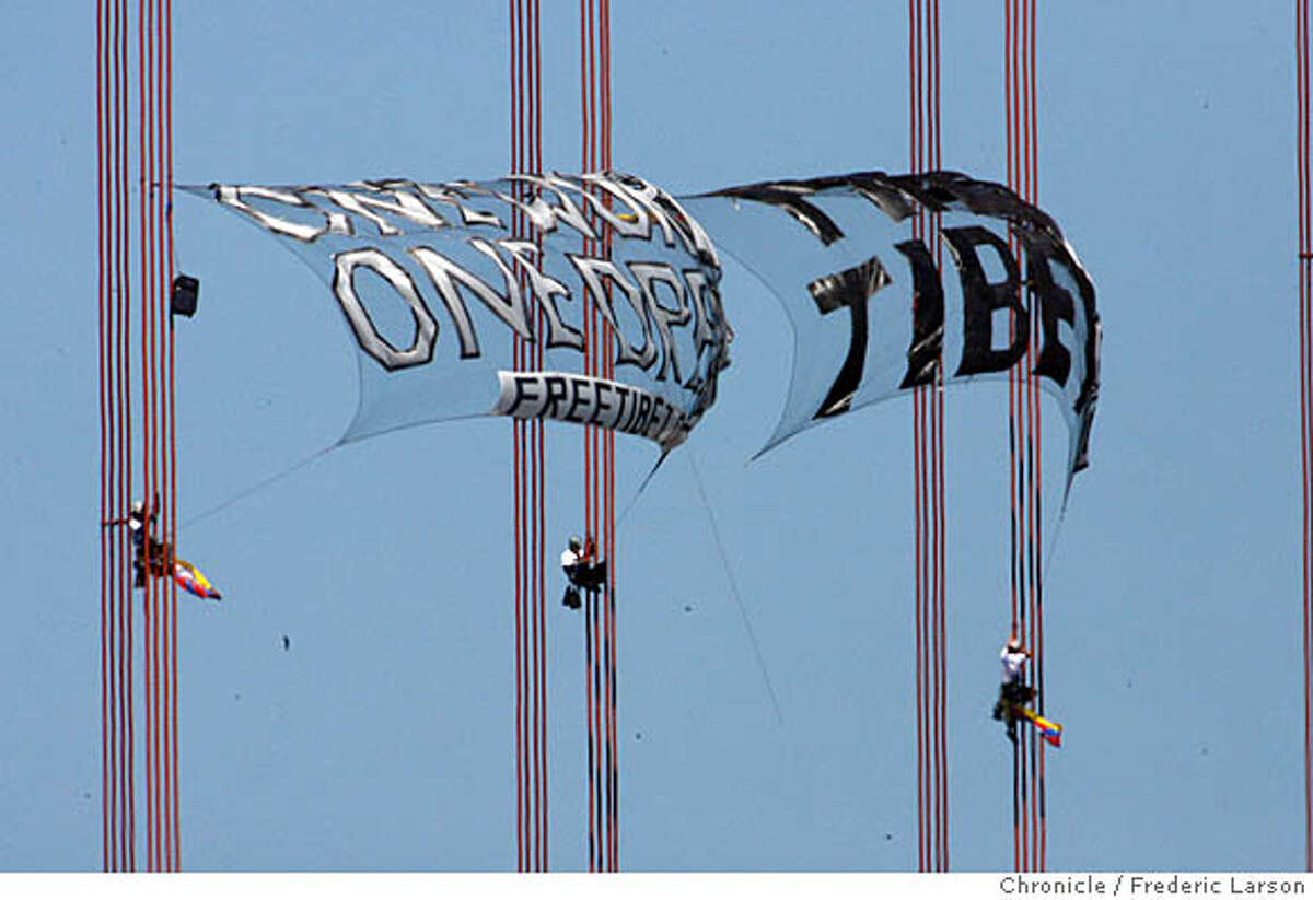 Three protester climb the cables of teh Golden Gate Bridge in protest of freeing Tibet China. 4/7/08 Photo by Frederic Larson / San Francisco Chronicle