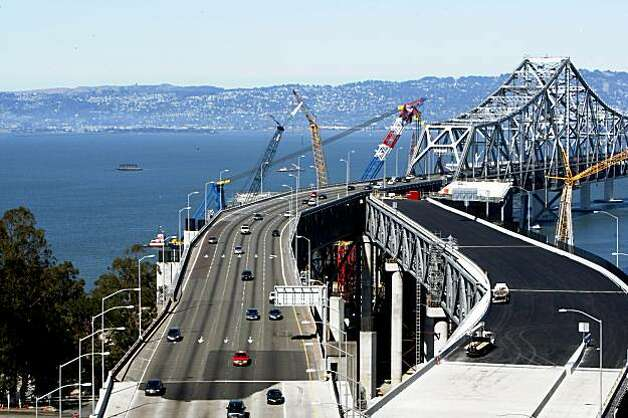 A 300-foot double-desk section of the Bay Bridge east of Yerba Buena Island Tunnel left will be cut and slid away on Labor Day weekend. The new temporary replacement right will be slid into place allowing for the removal of the old span. The new detour will be a slightly different drive as the roadway curves to the south, requiring drivers to slow down while approaching or leaving the tunnel. Aug 26, 2009. Photo: Lance Iversen, The Chronicle
