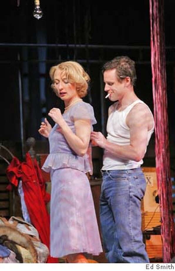 Blanche DuBois (Carrie Paff) teases Stanley Kowalski (Daniel May) by asking him to button up her back. Photo: Photo By: Ed Smith