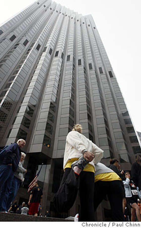 Nicole Tone, center, stretches at the base of the 555 California building before the second annual California stair in San Francisco, Calif., on Saturday, March 29, 2008. Nearly 1,000 participants climbed the 1,197-step stairwell in the 52-story skyscraper.  Photo by Paul Chinn / San Francisco Chronicle Photo: Paul Chinn