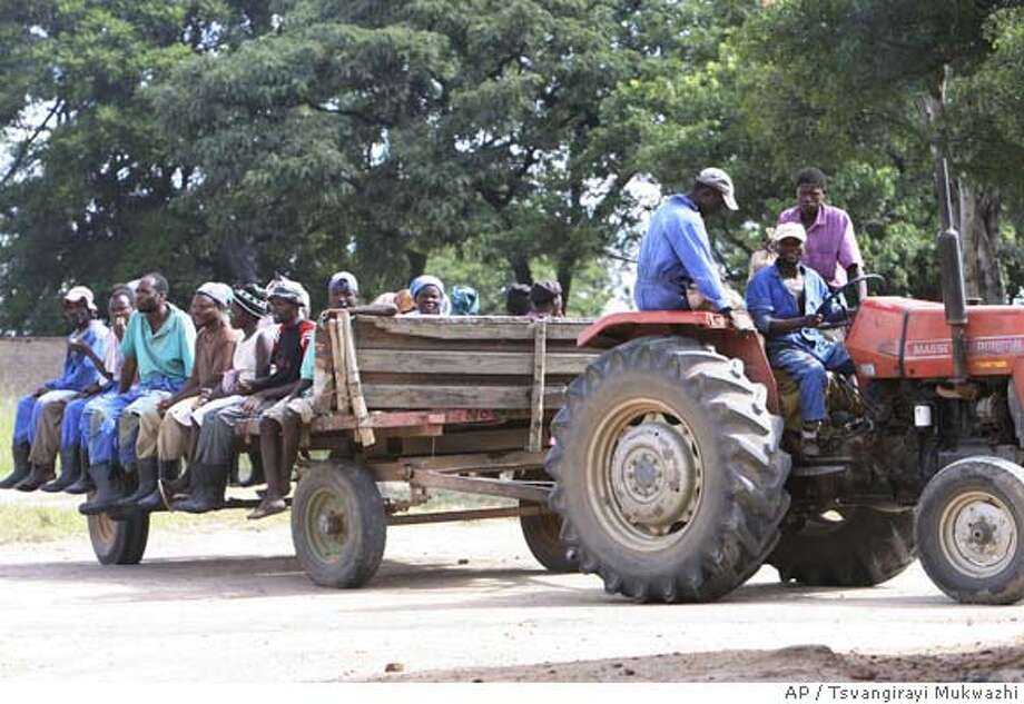 ###Live Caption:Farm workers at a farm in Karoi about 200 kilometers west of Harare are driven away to their homesteads following threats by War Veterans to occupy the farm owned by a white farmer who refused to be named for fear of victimization in Karoi, Zimbabwe Monday, April, 7, 2008. Zimbabwe which held elections on the march 29, and is still to release full results, has seen fresh farm Invasions triggered by War Veterans threatening to occupy all the few farms still occupied by white farmers in Zimbabwe. (AP Photo/Tsvangirayi Mukwazhi)###Caption History:Farm workers at a farm in Karoi about 200 kilometers west of Harare are driven away to their homesteads following threats by War Veterans to occupy the farm owned by a white farmer who refused to be named for fear of victimization in Karoi, Zimbabwe Monday, April, 7, 2008. Zimbabwe which held elections on the march 29, and is still to release full results, has seen fresh farm Invasions triggered by War Veterans threatening to occupy all the few farms still occupied by white farmers in Zimbabwe. (AP Photo/Tsvangirayi Mukwazhi)###Notes:###Special Instructions: Photo: TSVANGIRAYI MUKWAZHI
