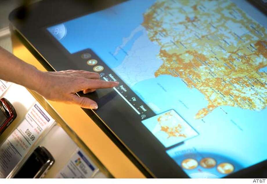 AT&T will the first company to utilize Microsoft's Surface touch-screen tables. Visitors to AT&T stores will be able to get information about phones and check coverage maps using the interactive touch-screen. The AT&T Experience Store in San Bruno will one of five stores that will get the device on April 17. Photo: AT&T