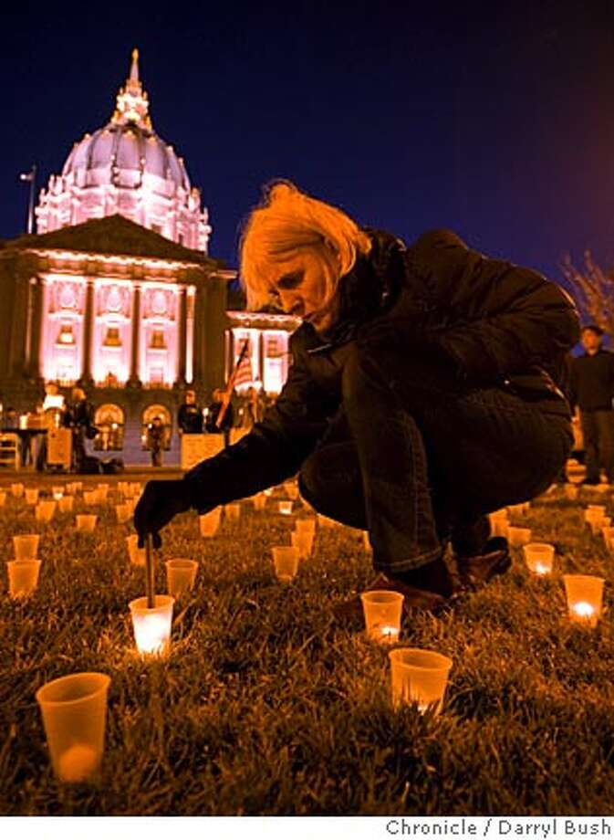 Este Cantor of Berkeley, Calif., lights one of 4,000 candles during a demonstration at Civic Center Plaza in San Francisco, Monday, March 24, 2008 to commemorate the 4,000 U.S. soldiers killed in Iraq. (AP Photo/Darryl Bush) Photo: Darryl Bush