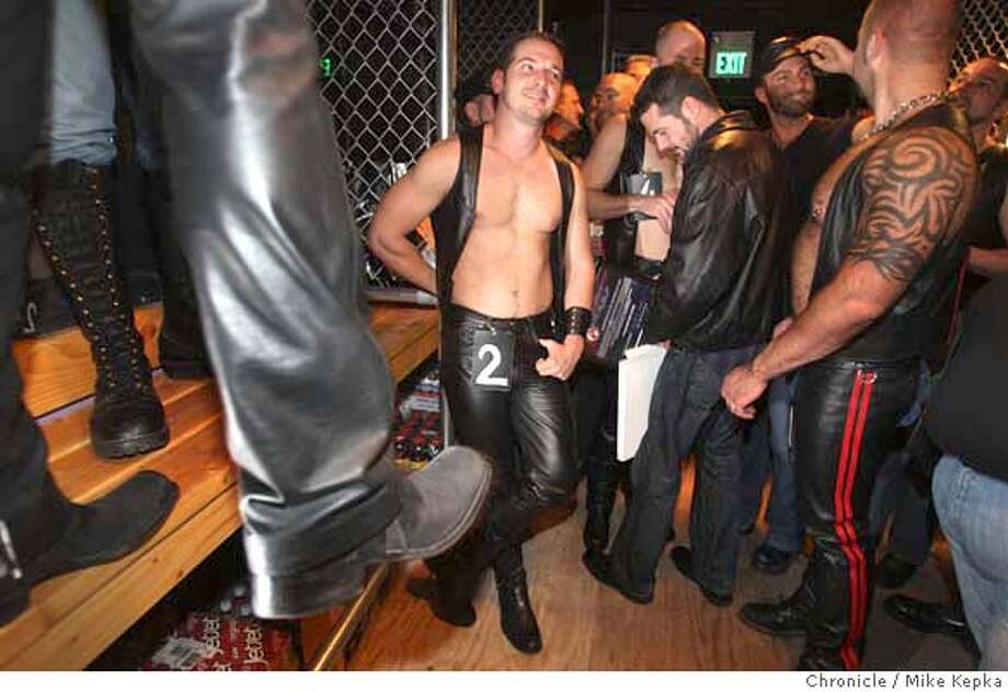 Mr. SF Leather contestants, Ron Balos (left) makes an appearance at the opening of Chaps II, the city's newest leather bar, on Friday, April, 04, 2008 in San Francisco, Calif. This is the first bar of it kind to open here in more that 10 years. Photo by Mike Kepka / San Francisco Chronicle Ran on: 04-07-2008  Ron Balos (No. 2), a participant in the Mr. San Francisco Leather contest, mingles at the grand opening of Chaps II on Folsom Street Friday. Photo: Kepka
