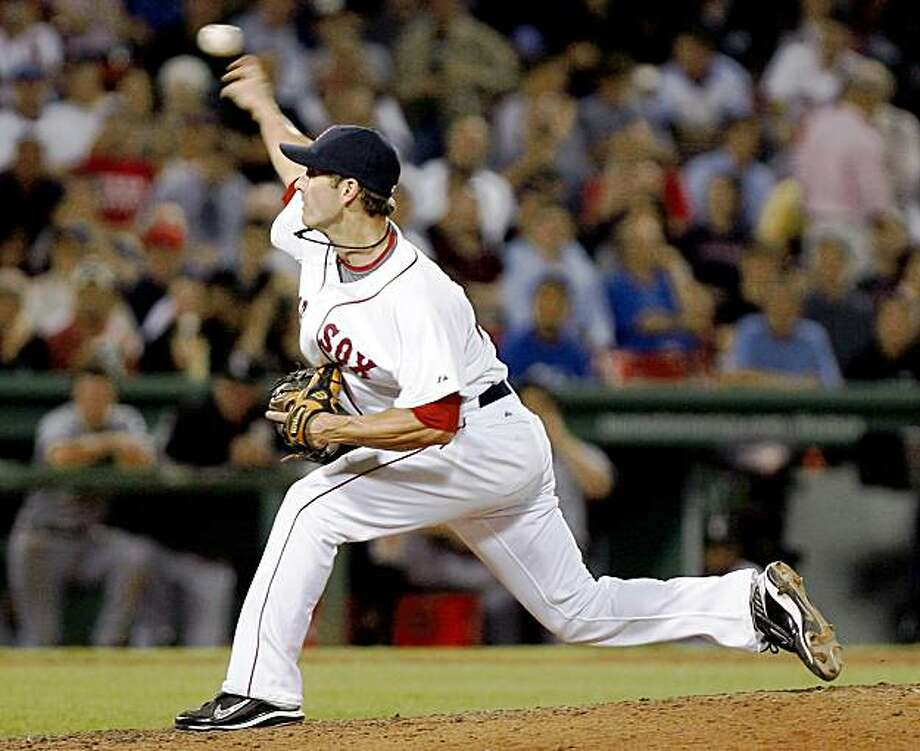 Boston Red Sox's Nick Green pitches during the eighth inning of a baseball game against the Chicago White Sox at Fenway Park in Boston, Thursday, Aug. 27, 2009. (AP Photo/Mary Schwalm) Photo: Mary Schwalm, AP