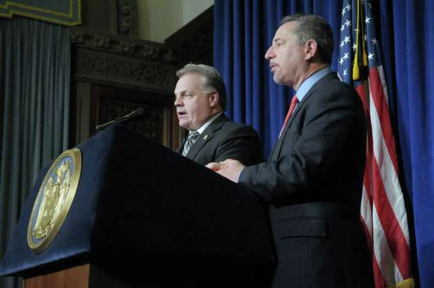 Donn Rowe, left, president of the New York State Correctional Officers and Police Benevolent Association, and Howard Glaser, director of state operations, hold a press conference to announce a tentative contract agreement between the state and the union on Thursday, Feb. 9, 2012 at the capitol in Albany, NY.  (Paul Buckowski / Times Union) Photo: Paul Buckowski