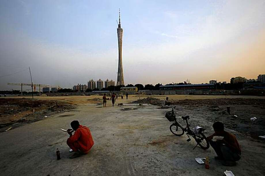 "In this photo taken Thursday, Aug. 20, 2009, workers eat a meal at a construction site near the new TV tower in the southern city of Guangzhou, China. Guangzhou, China's third-wealthiest metropolis wants to win the coveted ""Civilized City"" award an annual ritual that sparks months of frantic scrubbing and buffing in cities across China. (AP Photo/Vincent Yu) Photo: Vincent Yu, AP"