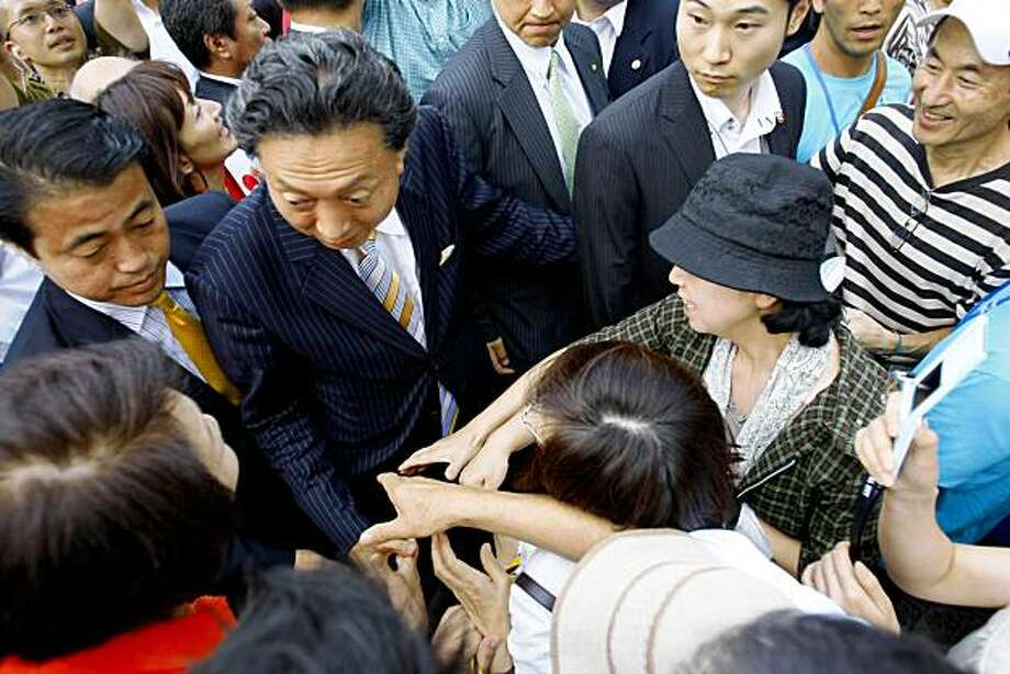 n this photo taken Aug. 18, 2009, Democratic Party of Japan leader Yukio Hatoyama, center left, greets supporters as he kicks off parliamentary election campaign in Yokohama, near Tokyo, Japan. Japan's voters are widely forecast to end one of the most successful runs by a political party in the modern, noncommunist world when they go to the polls on Aug. 30 for parliamentary elections that may well have far-reaching repercussions on Washington's staunchest Asian ally and the stewardship of the world's second-largest economy. (AP Photo/Shizuo Kambayashi) Photo: Shizuo Kambayashi, AP