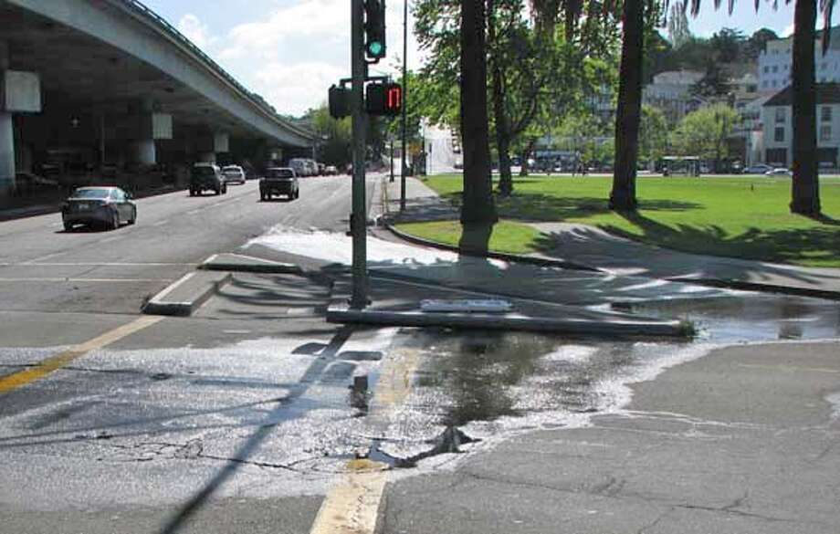 ###Live Caption:Due to a small break in the water main, a puddle has been forming along Grand Avenue by MacArthur Boulevard in Oakland. Repairs are promised next week.###Caption History:Due to a small break in the water main, a puddle has been forming along Grand Avenue by MacArthur Boulevard in Oakland. Repairs are promised next week.###Notes:###Special Instructions: Photo: Elizabeth Fernandez