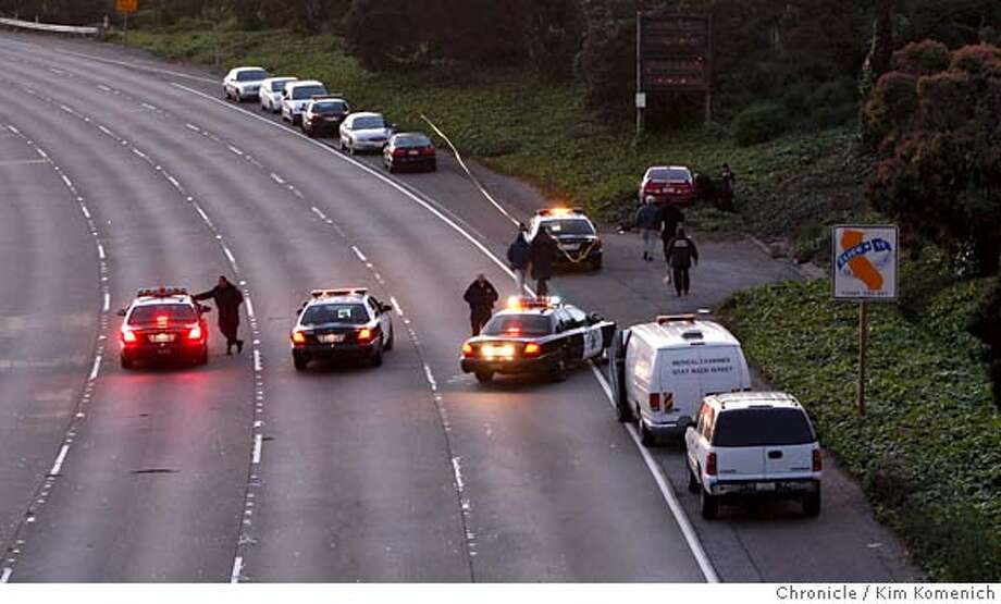 Investigators document the scene of a homicide that happened on southbound Interstate 280 between the Alemany and Monterey exits in San Francisco on Wednesday, April 9, 2008.  Photo by Kim Komenich / San Francisco Chronicle Photo: Kim Komenich