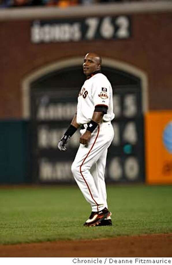###Live Caption:Barry Bonds walks past sign with his homerun record as he plays his final game at AT&T Park as a San Francisco Giant in game against San Diego Padres. Photographed in San Francisco on 9/26/07. Deanne Fitzmaurice / The Chronicle###Caption History:bonds_634_df.jpg  Barry Bonds walks past sign with his homerun record as he plays his final game at AT&T Park as a San Francisco Giant in game against San Diego Padres. Photographed in San Francisco on 9/26/07. Deanne Fitzmaurice / The Chronicle###Notes:###Special Instructions:Mandatory credit for photographer and San Francisco Chronicle. No Sales/Magazines out. Photo: Deanne Fitzmaurice