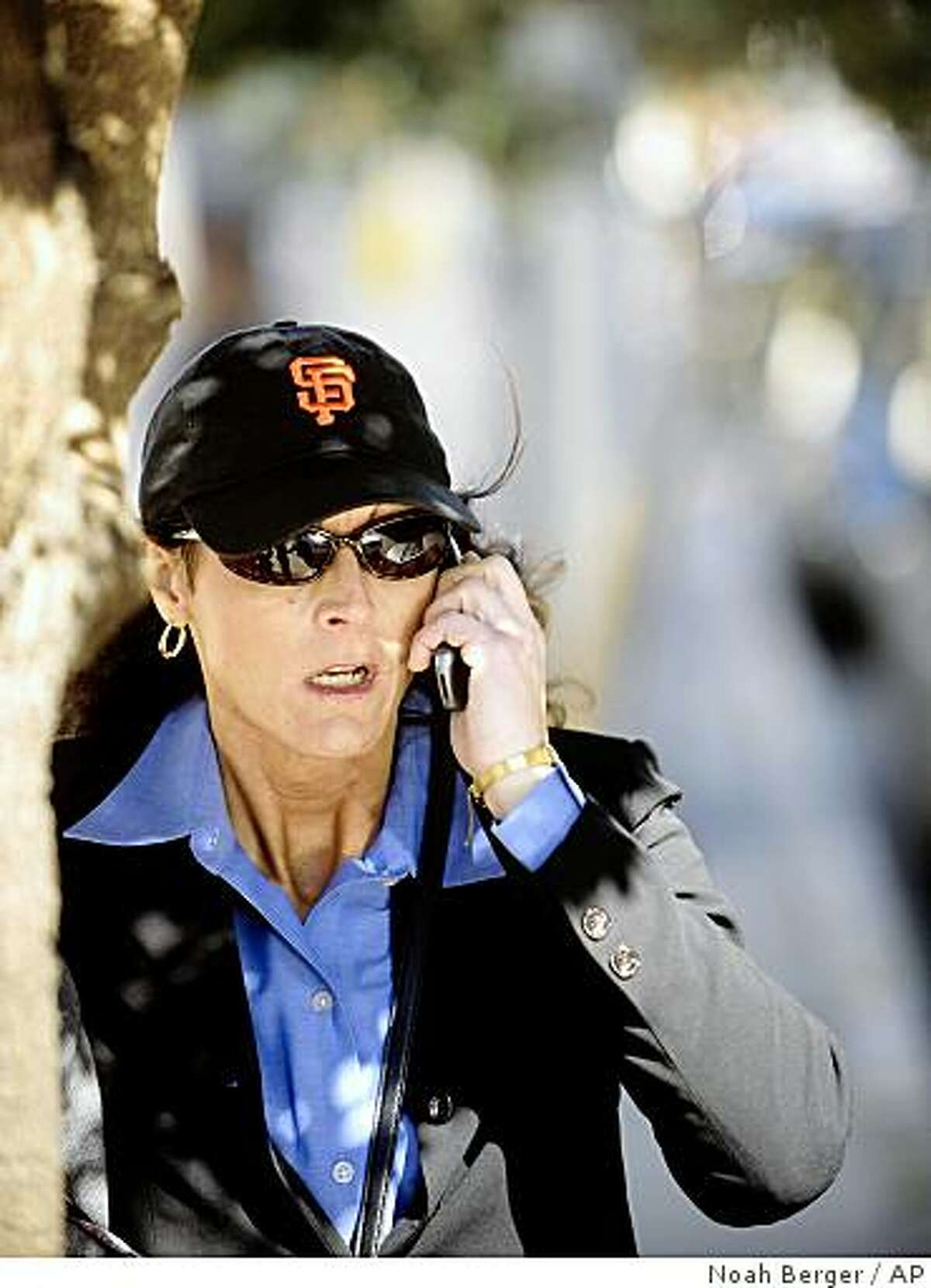 Former Olympic cyclist Tammy Thomas talks on her cell phone as she leaves the federal courthouse in San Francisco on Tuesday, March 25, 2008. Thomas is charged with perjury and obstruction of justice for allegedly lying to a federal grand jury investigating a steroid ring that spanned many sports.