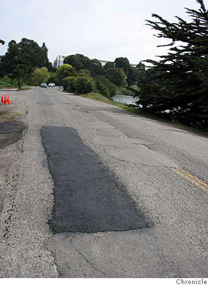 Caltrans has freshly patched potholes on the approach to an Interstate 80 on ramp in Berkeley. More potholes remain on the roadway -- Bolivar Drive and Potter Street -- that are Berkeley's responsibility. Photo: John Cote