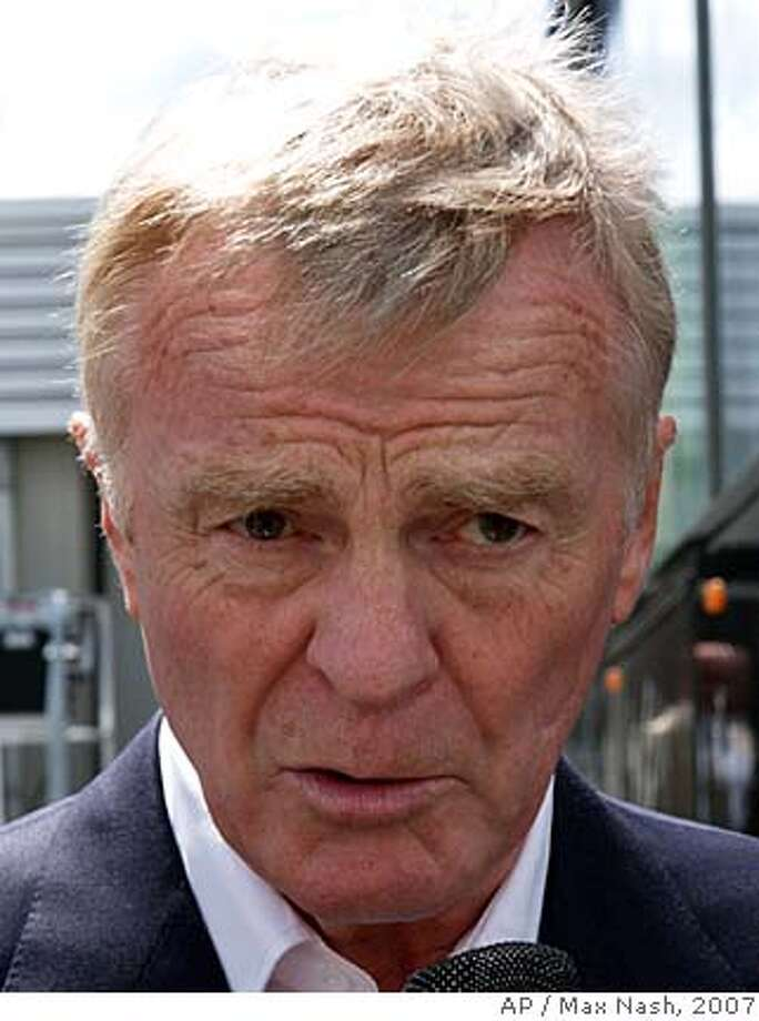 "** FILE ** Max Mosley, president of the FIA, motor sport's governing body, answers reporters questions regarding the issue between McLaren and Ferrari, at the paddock at Silverstone, England, in this July 7, 2007 file photo. FIA wants to stay clear of the situation involving its president, Max Mosley, and a British tabloid that reported he engaged in sexual acts with five prostitutes in a scenario that involved Nazi role-playing. ""This is a matter between Mr. Mosley and the newspaper,"" the governing body of world auto racing said Sunday, March 30, 2008. Mosley, the son of British Union of Fascists party founder Oswald Mosley, reportedly took part in the scene on Friday at a London apartment near his home, according to the News of the World in a front-page story. (AP Photo/Max Nash) Photo: MAX NASH"