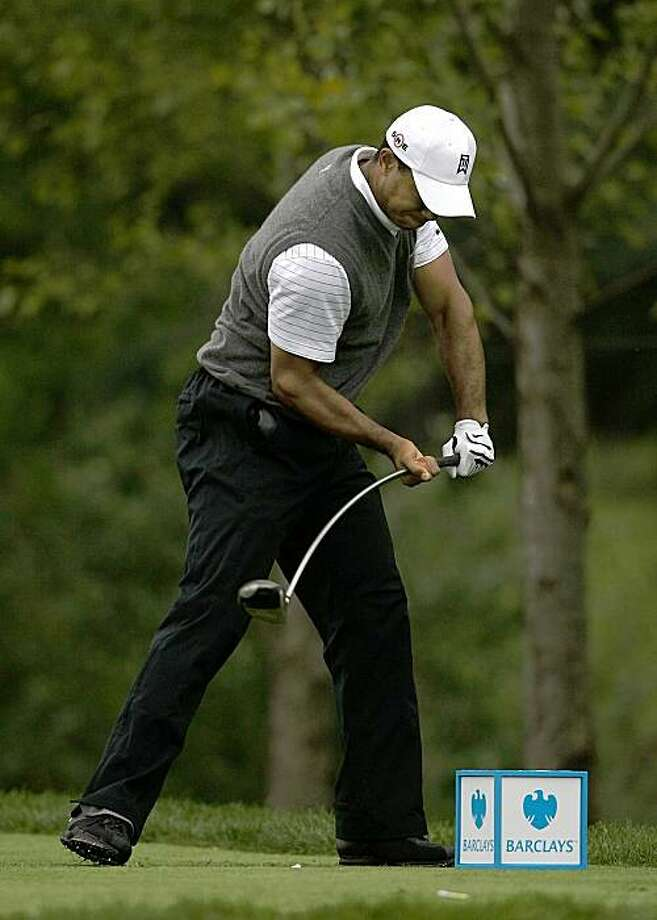 JERSEY CITY, NJ - AUGUST 28:  Tiger Woods reacts to his hooked tee shot on the 16th hole during roudn two of The Barclays on August 28, 2009 at Liberty National in Jersey City, New Jersey.  (Photo by Nick Laham/Getty Images) Photo: Nick Laham, Getty Images