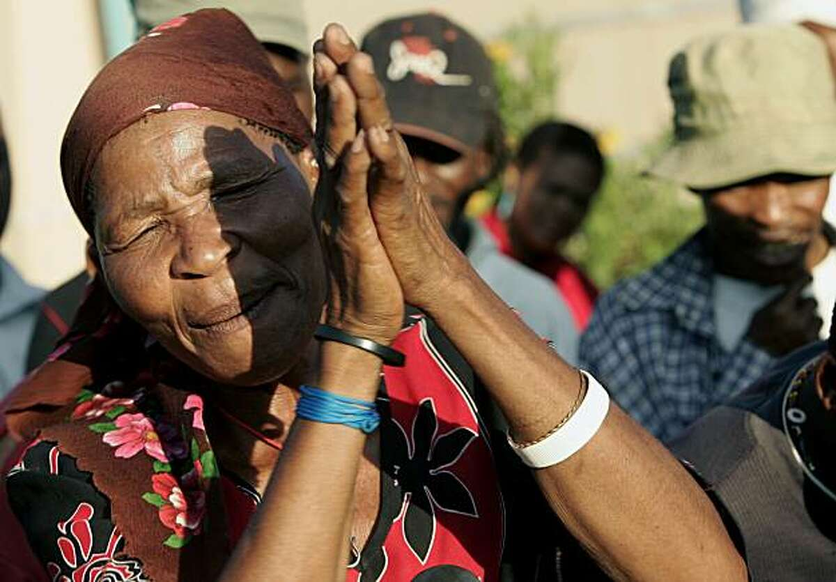 A member of the Kalahari Bushmen community celebrates a court ruling on their eviction from ancestral grounds.