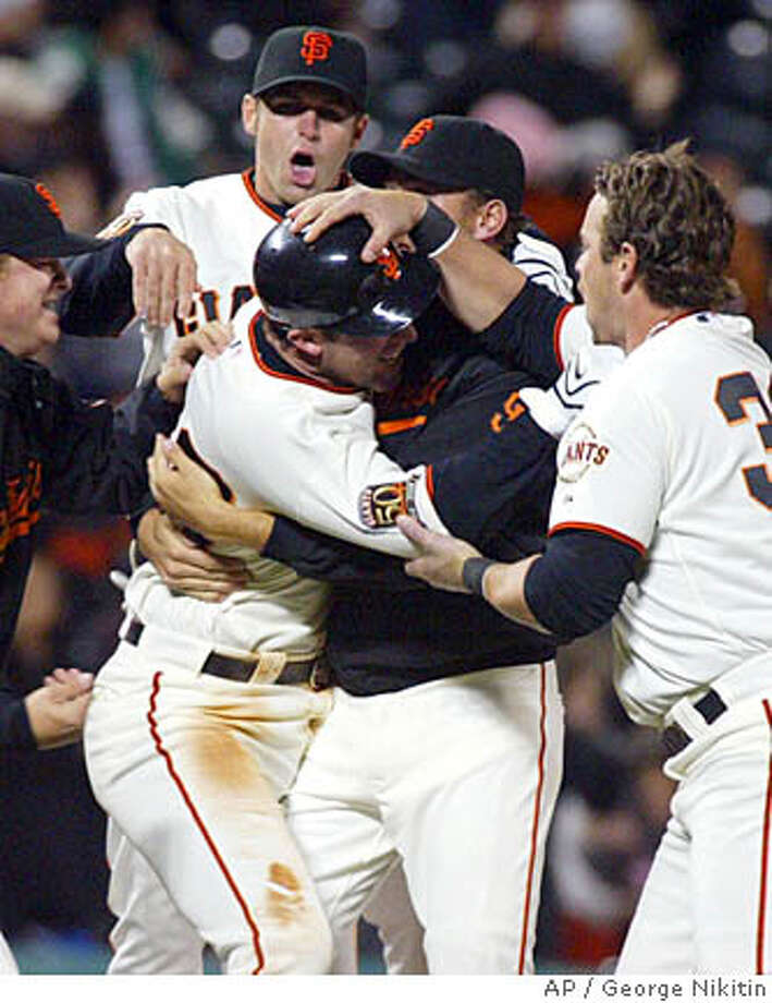 San Francisco Giants Daniel Ortmeier, center, celebrates with teammates after hitting a game winning double in the ninth inning of a baseball game against the San Diego Padres, Wednesday, April 9, 2008 in San Francisco. The Giants beat the Padres 1-0. (AP Photo/George Nikitin) Photo: George Nikitin